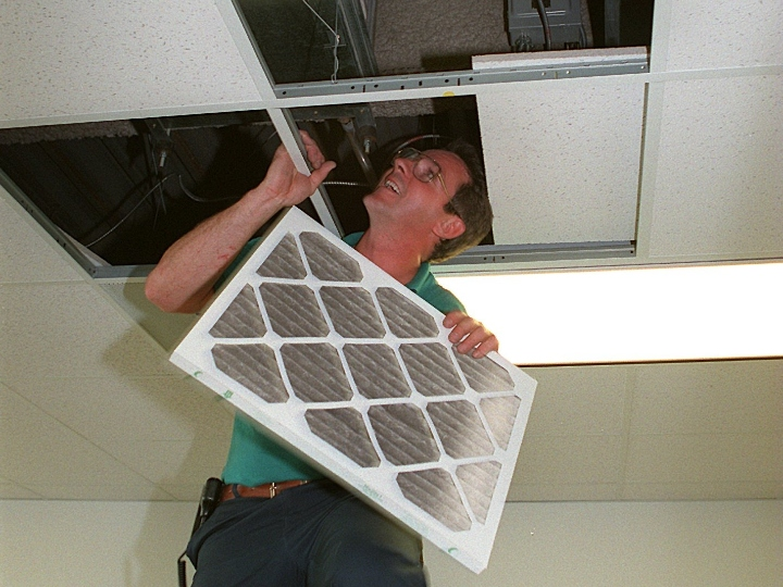 Building engineer at the Registry Headquarters, Mike Shearns, holds an air filter from and air vent in the ceiling of the 9th floor which he inspected. The ninth floor housed the payroll department, where many employees felt the effects of the bad air.