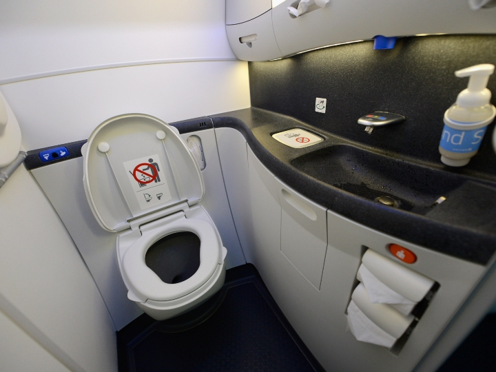 A touch lavatory is seen on the United Airlines Boeing 787 Dreamliner at Los Angeles International Airport on November 30, 2012 in Los Angeles, California. In January the new jet is scheduled to begin flying daily non-stop between Los Angeles International airport and Japan's Narita International Airport and later to Shanghai staring in March. The new Boeing 787 Dreamliner will accommodate 219 travelers with 36 seat in United Business First, 70 seats in Economy Plus and 113 in Economy Class. The carbon-fiber composite material that makes up more than 50 percent of the 787 makes the plane jet and more fuel-efficient