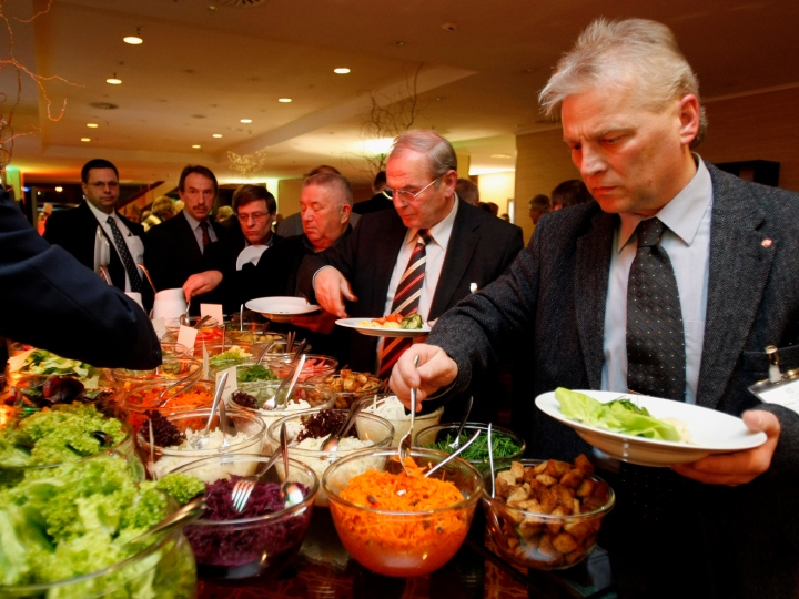 People stand at the buffet during the DFB LIVE event in the Marriott Hotel on March 6, 2009 in Frankfurt am Main, Germany