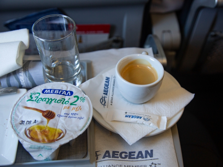 In flight breakfast meal during a flight in business class with Aegean Airlines from Athens. Aegean offers a variety of great and tasty options in meals for business class passengers. They provide also espresso coffee and many options of alcoholic drinks, specially local wines.