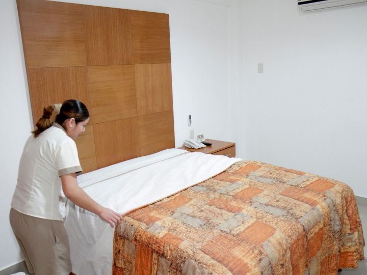 Mexico, Yucat‡n Peninsula, Quintana Roo, Cancun, Suites Gaby budget hotel, housekeeping maid