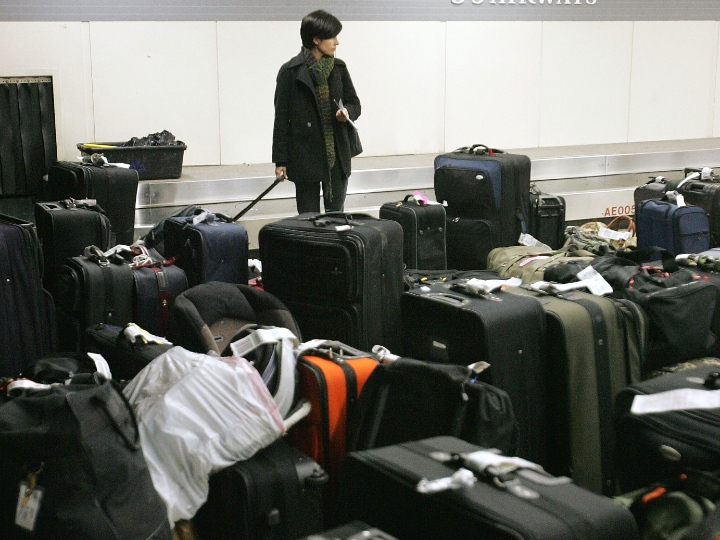 Elissa Totin of Evanston, Illinois, looks for her bags among yet-to-be claimed luggage at the US Airways baggage claim area at O'Hare International Airport December 28, 2004 in Chicago, Illinois. U.S. Transportation Secretary Norman Y. Mineta has asked the agency's Inspector General to join with the Department's Office of Aviation and International Affairs and Office of General Counsel to investigate travel disruptions that impacted US Airways and Comair passengers over the 2004 holiday travel weekend.