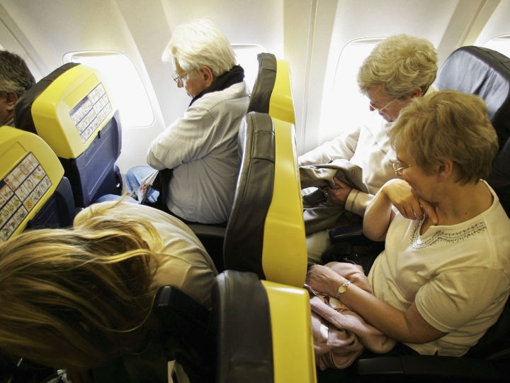 Passengers travel on a low cost flight to Dinard in France on May 15, 2006 from London. Low cost airlines are increasing their market share in Europe by offering flights as low as 14 pence (plus taxes) to destinations across the Continent.
