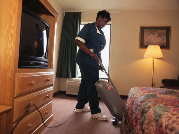 Marina Brown, a participant of the Bridges to Work program, cleans a room at the Hampton Inn. The program links intercity residents to metropolitan-wide opportunities.