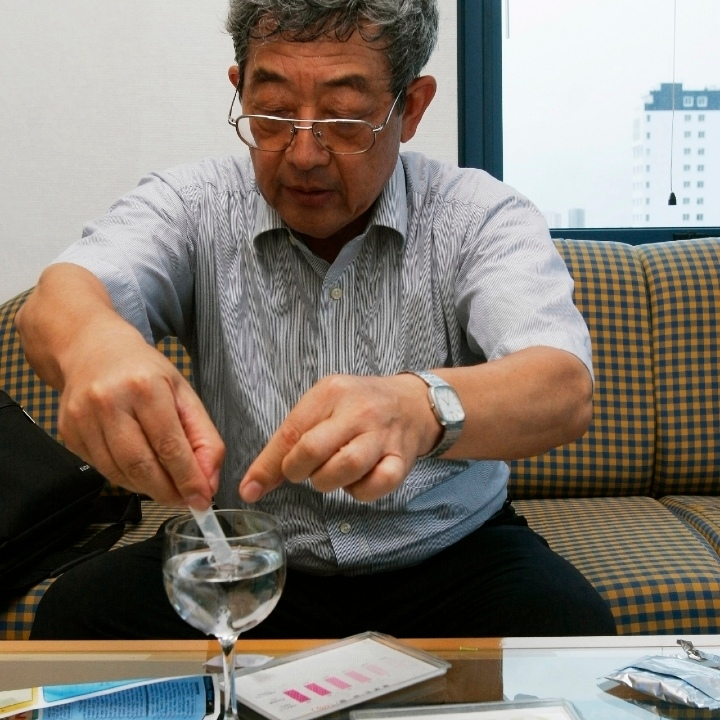 Prof. Yasuaki Maeda, a JICA (Japan International Cooperation Agency) expert, tests water at his appartment in the Daewoo Hotel in Hanoi, Vietnam.