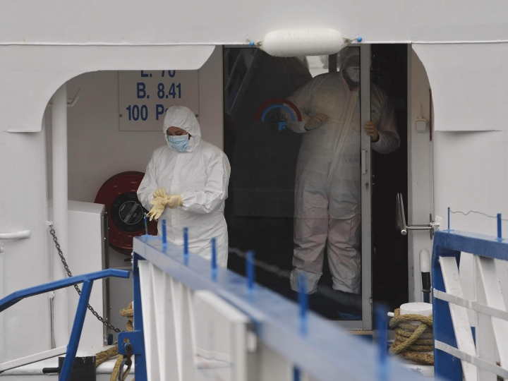 "Men in protective clothes work on the disinfection of the pleasure boat ""Lady Anne"", where the Norovirus broke out, on the Rhine river in Boppard, western Germany, on November 25, 2008. The ship with 110 passengers and crew members onboard was put under quarantine after 37 people came down with the virus causing gastroenteritis. The vessel of a British shipyard with mainly elderly tourists onboard was on a several days tour on the Rhine river."