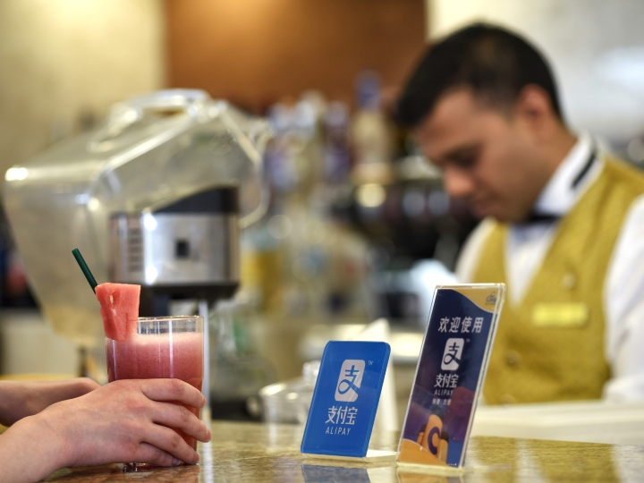 """A passenger orders a drink onboard cruise ship Costa Serena, June 9, 2017. In recent years, a number of China's technological innovations have been making their moves in the world. Among them, Dockless Shared Bicycles, High-speed Rail, Alipay and E-commerce stand out with a reputation of China's """"four great new inventions"""" in modern times, which have made the daily life of the public more and more convenient."""