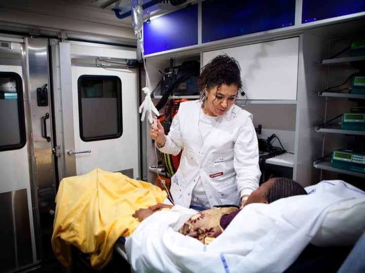 Reportage on Robert Ballanger Hospital's emergency medical team in Aulnay-Sous-Bois, France. A nurse treats a patient in the emergency vehicle.