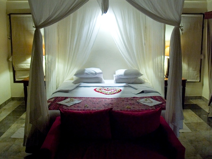 A canopy bed welcomes tourists with a heart in Komaneka hotel on February 19, 2010 in Ubud, Central Bali, Indonesia.