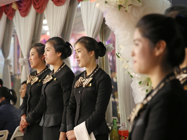 Staff members serve guests during a wedding ceremony on a luxury ship on October 25, 2018 in Pyongyang, North Korea. A newly-wed couple held their weeding ceremony on the luxury ship accompanied with music and dance performances from guests and performing groups. The wedding menu included twelve North Korean courses, wine and beers. It is said that about RMB 5,000 yuan will cover the total wedding expense on the cruise ship in Pyongyang.