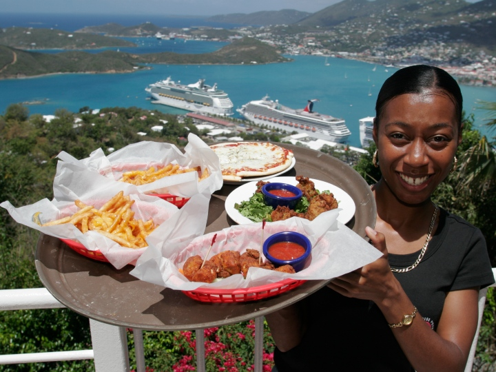 A waitress with a tray of food at Paradise Point.