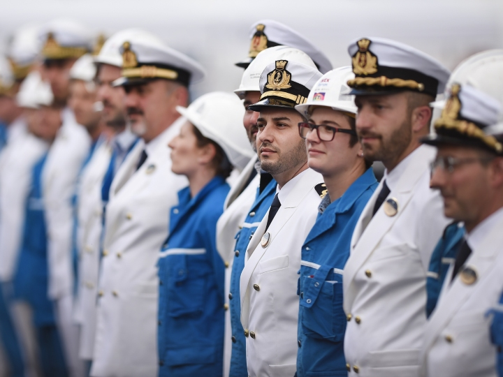 Workers and crew members gather during the delivery ceremony of the MSC Meraviglia cruise ship, on May 31, 2017 at the STX shipyard of Saint-Nazaire, western France. With a capacity of 65700 passengers and 1550 crew members, the MSC Meraviglia is the biggest cruise ship in Europe.